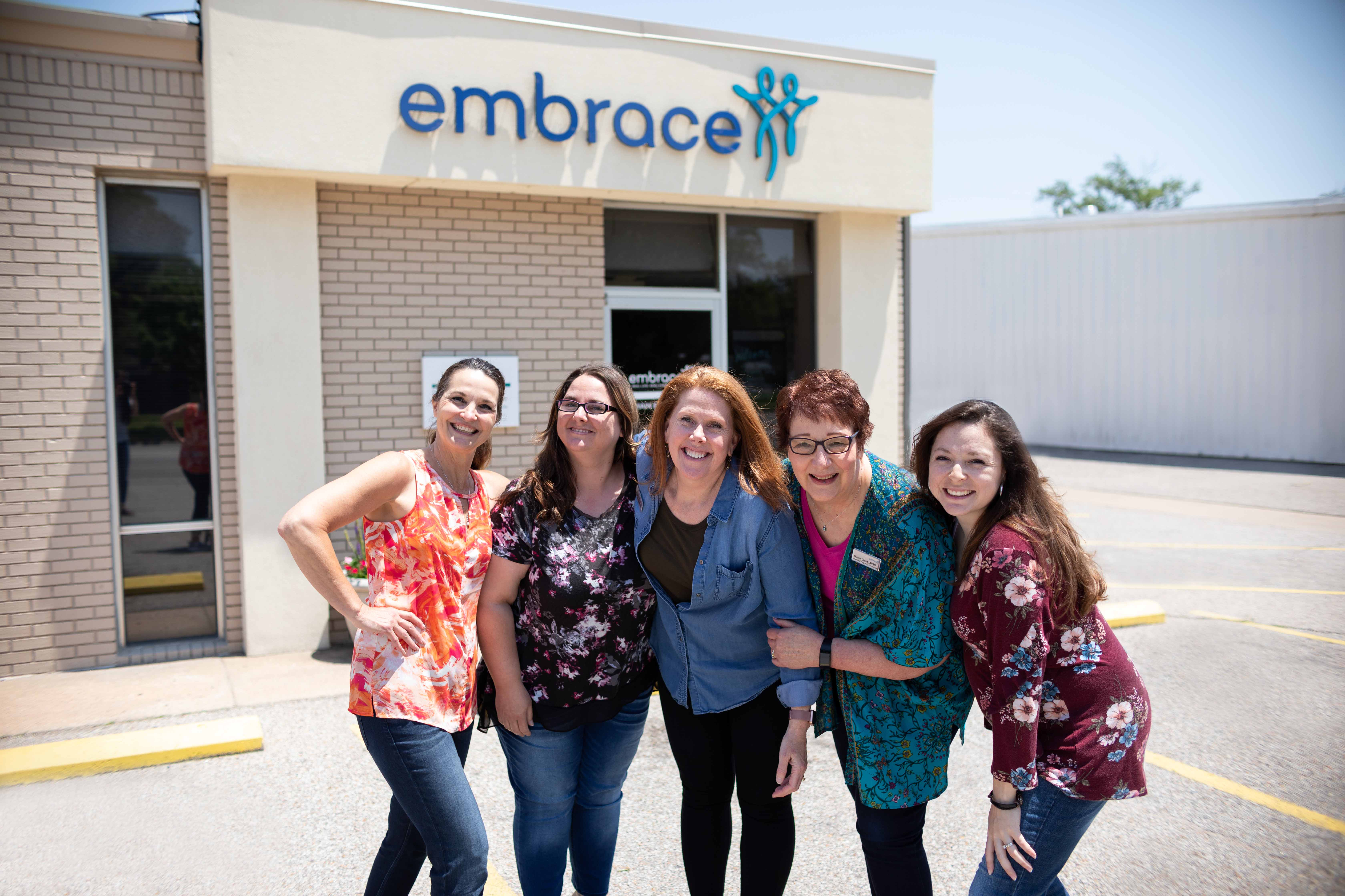 Smiling staff members at Embrace, Wichita